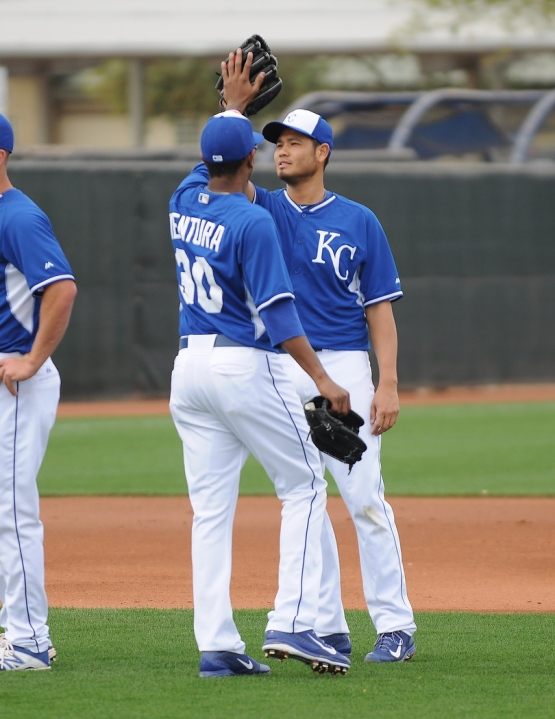 Yordano Ventura and Bruce Chen congratulate one another on a job well done.