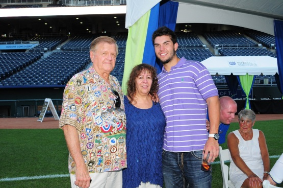 This 2011 photo shows Dick Kaegel with his wife Betty and Royals first baseman Eric Hosmer.